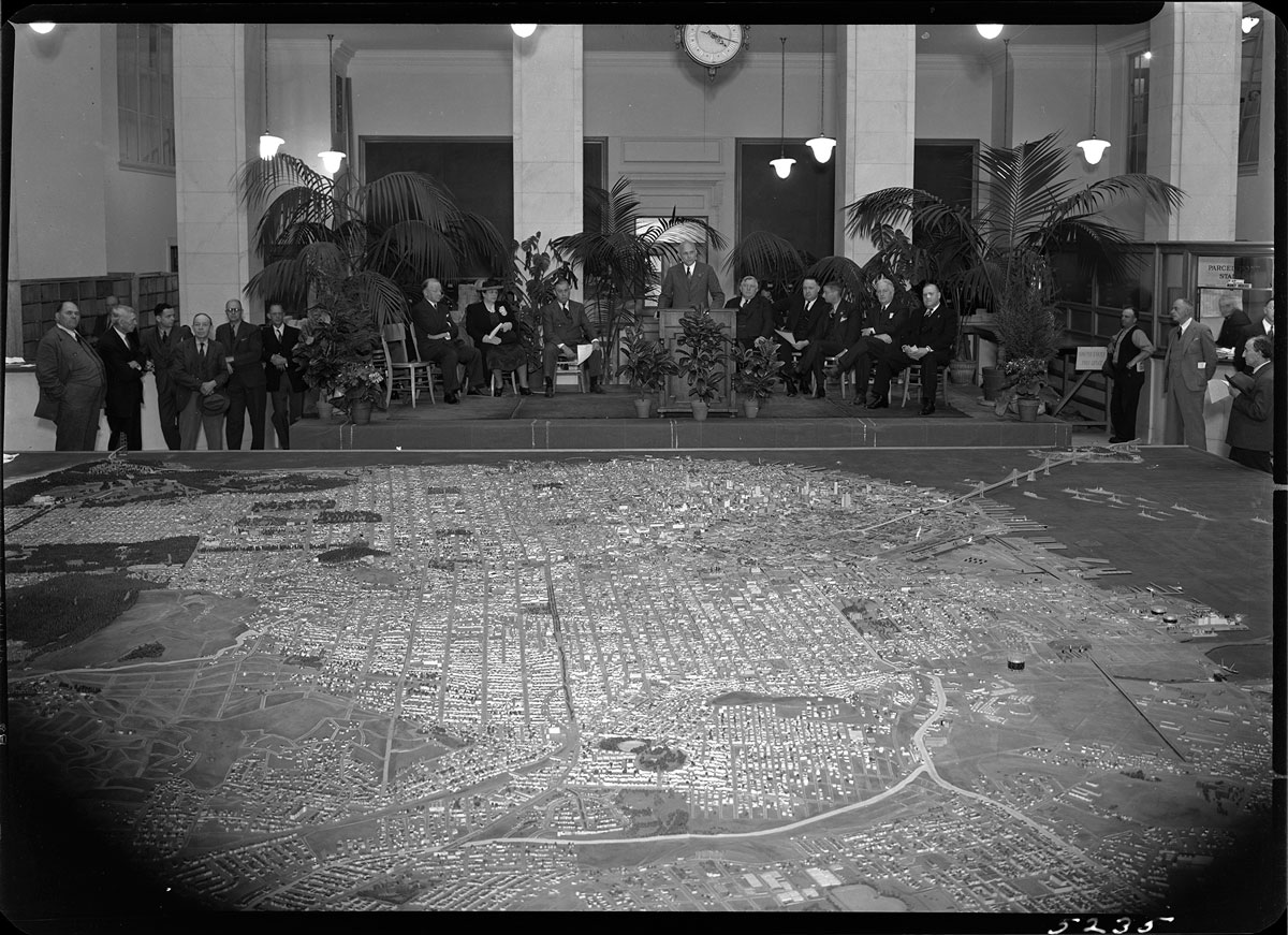 Unveiling of the scale model of San Francisco at City Hall, 1940; WPA, San Francisco Department of City Planning Records, San Francisco History Center.