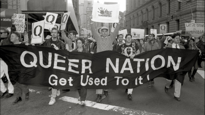 Queer Nation activists march at a New York City peace rally in October 1990.