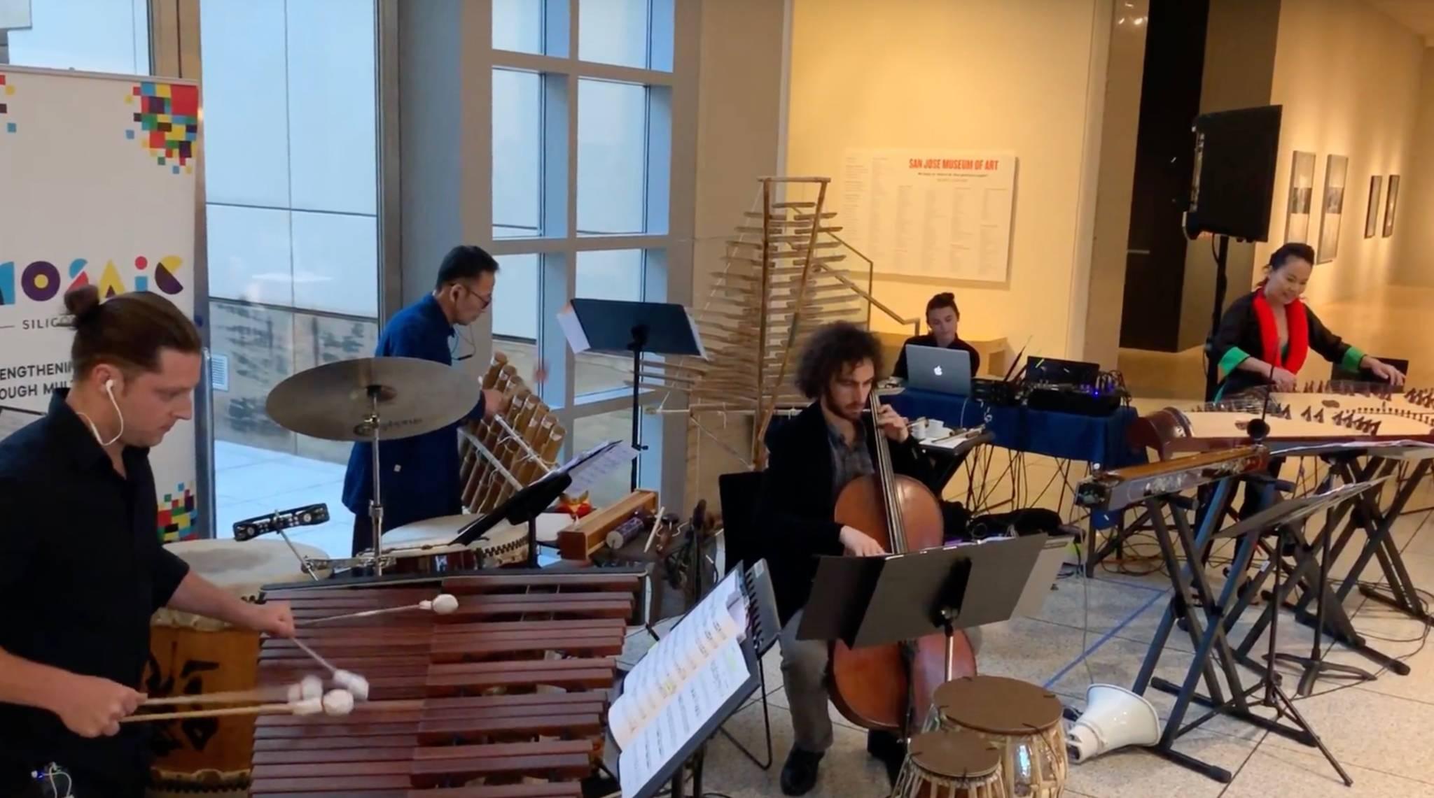 From left to right:Mikhael Khalikulov (cello, viola, electric bass) , Jimi Nakagawa (taiko, percussion), Joshua Mellinger (frame drum, trap set, tabla, marimba), Megan Ai, Vân-Ánh Võ (đàn tranh).