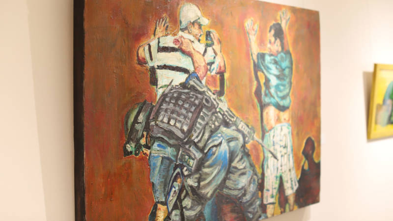 """Adrian Delgado's """"Search/Buscar"""" has remained in the show despite also showing a soldier with a gun."""