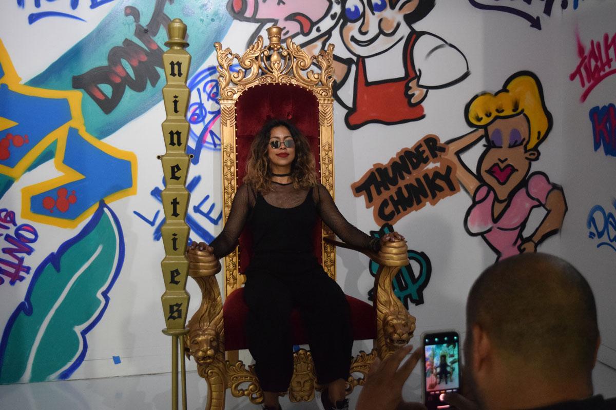 Artist Maria Garcia poses on a 'Fresh Prince' throne.