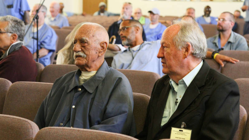 Curly Ray Martin (L), who once shared a cell with Merle Haggard, sits next to Country Music writer and co-producer Dayton Duncan (R).