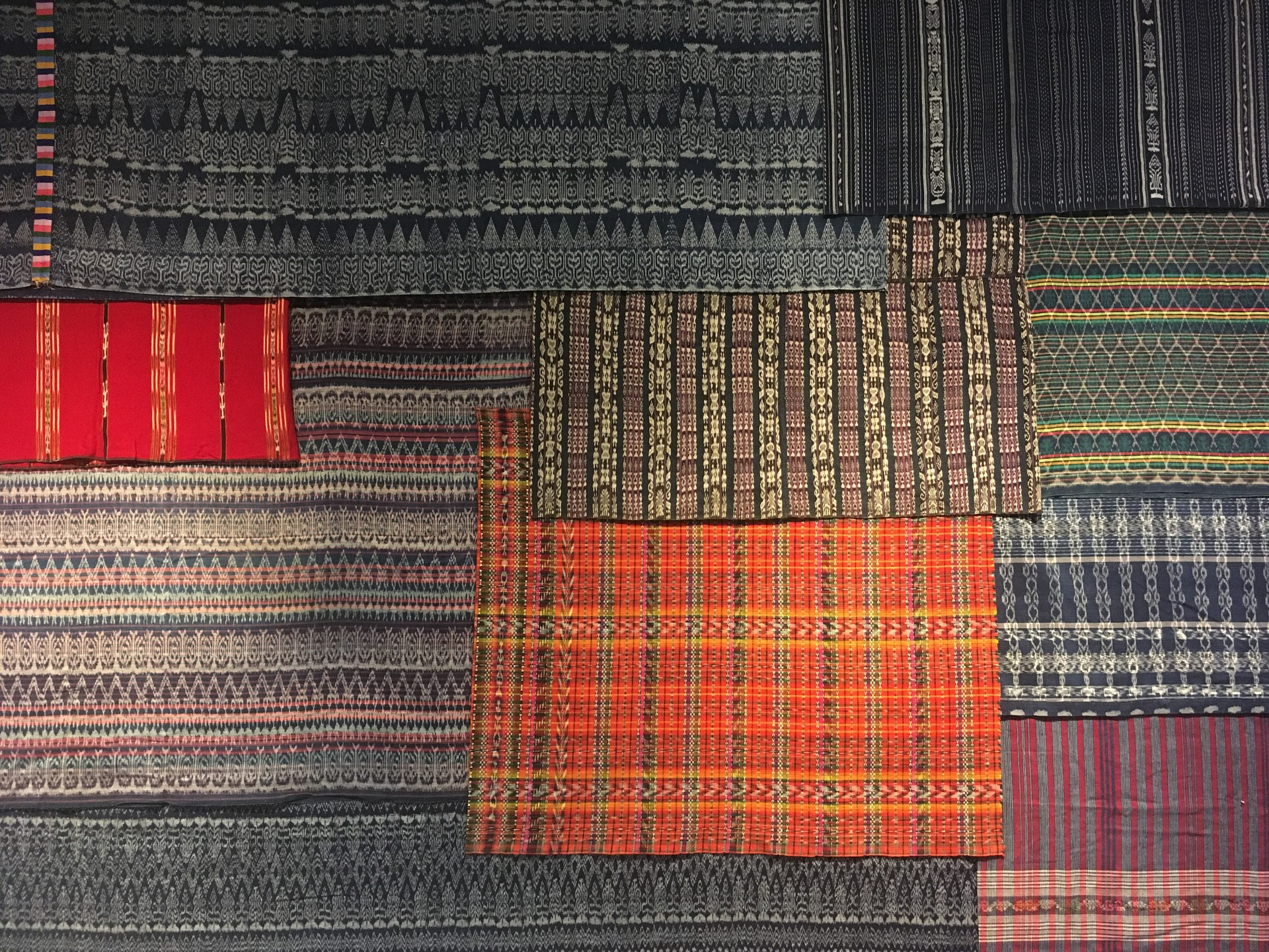 Behold the Wall of Skirts. These fabrics feature ikat, a dyeing technique used to pattern textiles that employs resist dyeing on the yarns prior to dyeing and weaving the fabric.