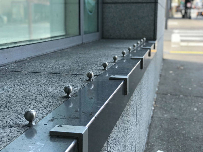 "A cafe on Larkin in the Tenderloin uses metal attachments to prevent people from sitting in an open windowsill. ""Being aware of hostile design helps people know what their city is interested in doing,"" says Kurt Kohlstedt."