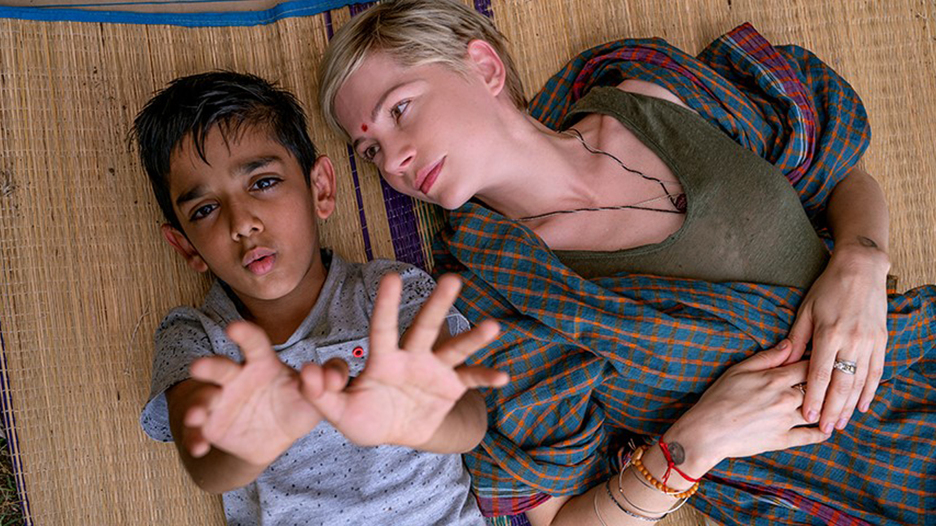 L to R: Vir Pachisia as Jai, Michelle Williams as Isabel.