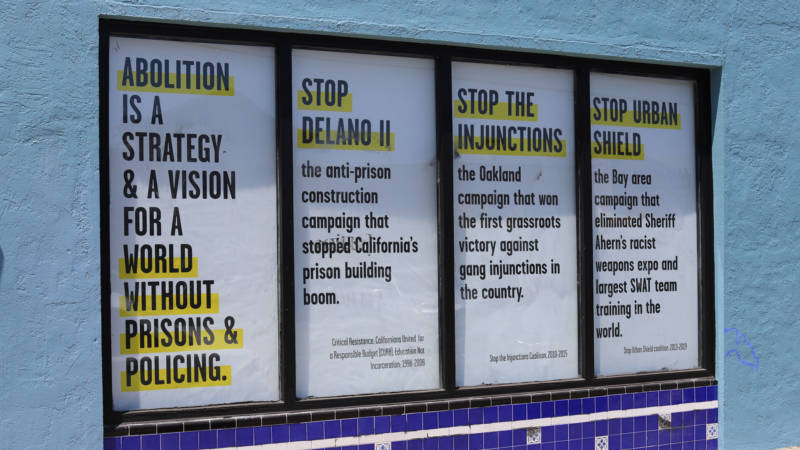 Critical Resistance marks successful and ongoing campaigns against the prison-industrial complex in the windows of its new building.