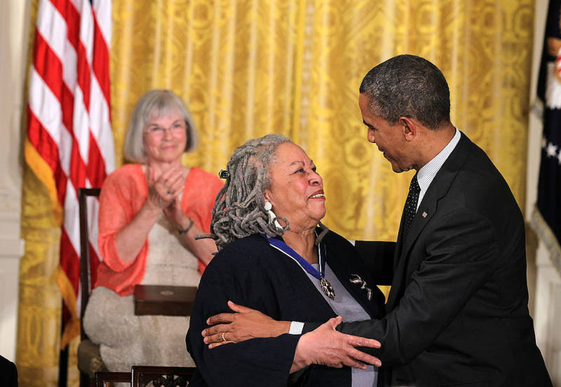 Novelist Toni Morrison and U.S. President Barack Obama share a moment after she was presented with a Presidential Medal of Freedom.