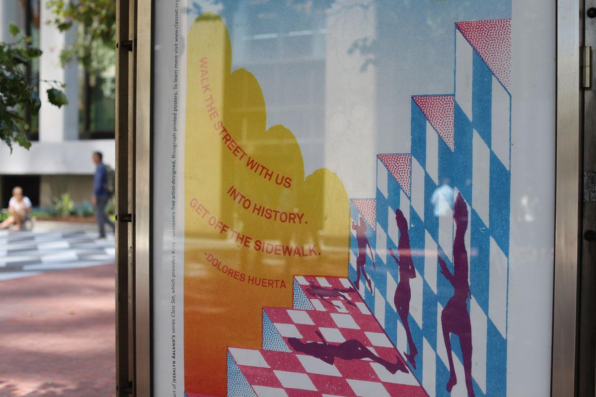 Poster designed by Jesjit Gil in a Market Street bus kiosk.