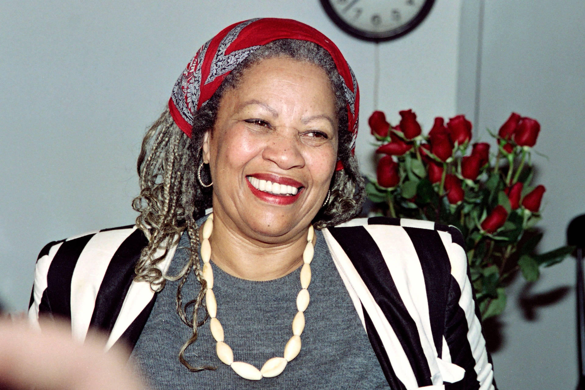 """U.S. author Toni Morrison smiles in her office at Princeton University in New Jersey, while being interviewed by reporters on October 7, 1993. - Morrison said """"I am outrageously happy"""" after hearing that she had won the Nobel Prize for Literature. DON EMMERT/AFP/Getty Images"""