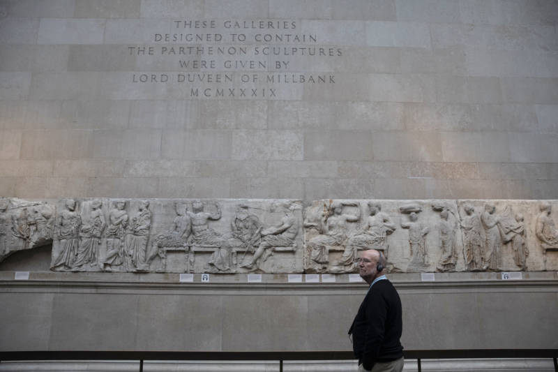 A tourist makes his way through classical sculptures from the Parthenon, also known as the Elgin marbles, at the British Museum in 2018.