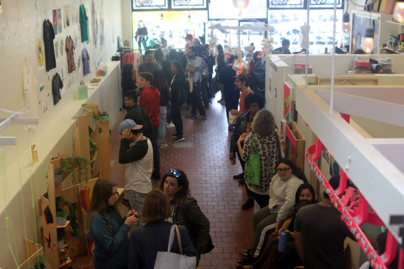 Students, parents and neighbors gather at Youth Art Exchange's X Space for a teen art show.
