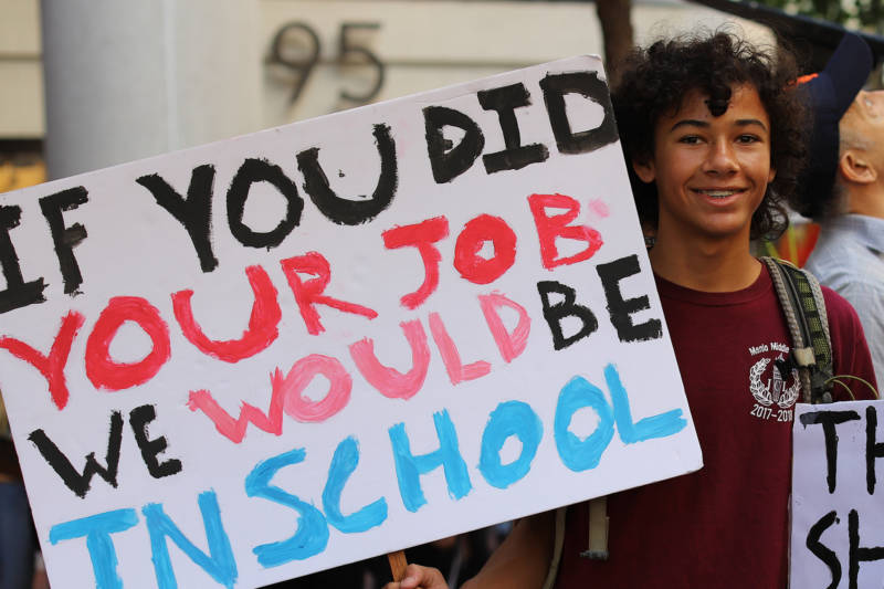 "Demonstrators at the Climate Strike in San Francisco on Sept. 20, 2019. A teenage boy holds a sign that says ""If you did your job we would be in school."""