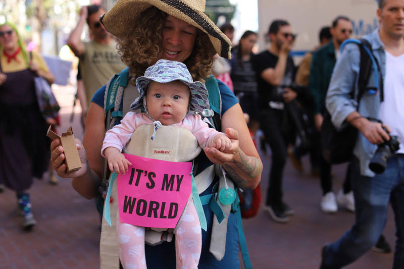 "Demonstrators at the Climate Strike in San Francisco on Sept. 20, 2019. A mother holds a baby with the sign ""It's my world."""