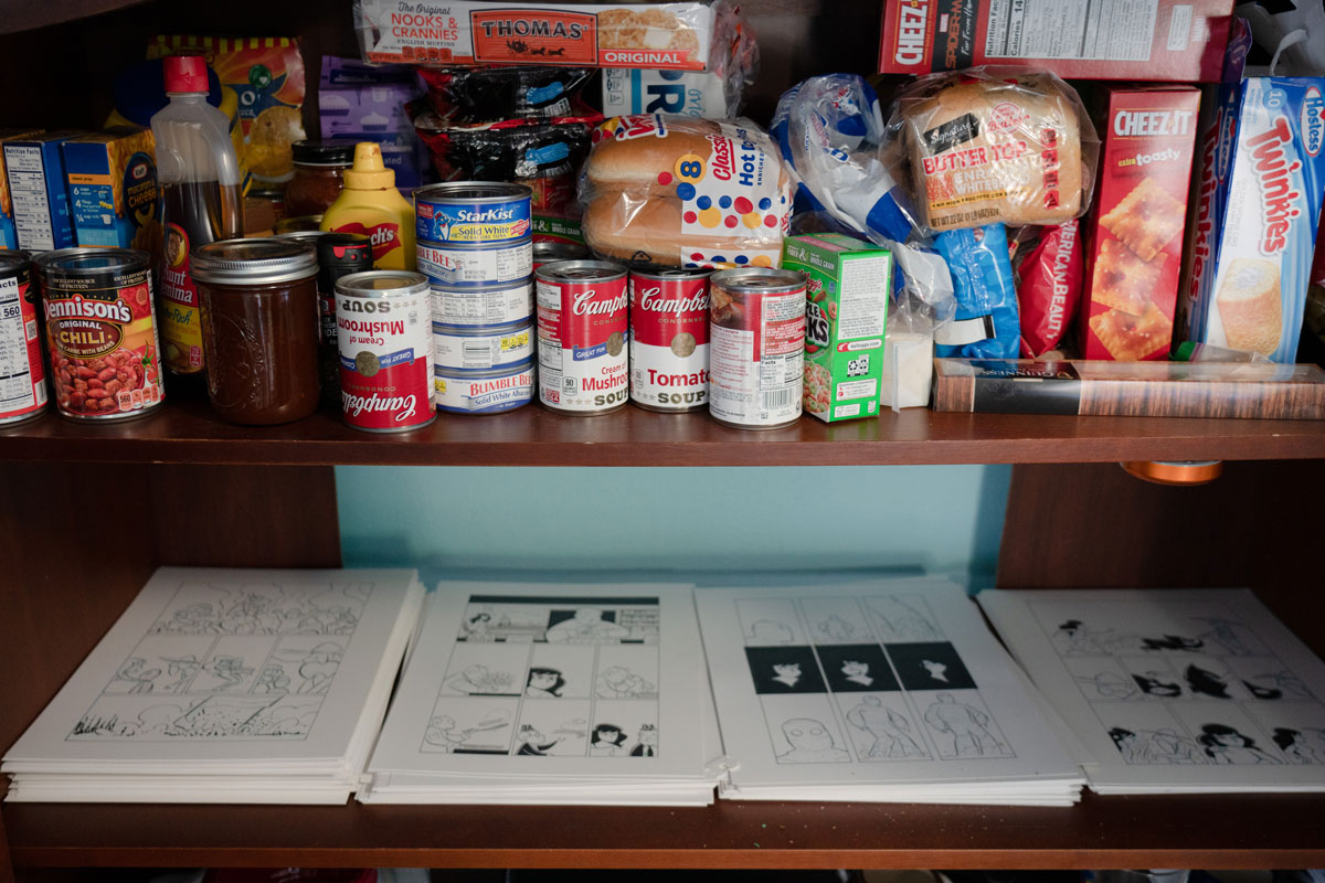 Beland's pantry holds food and stacks of drawings.