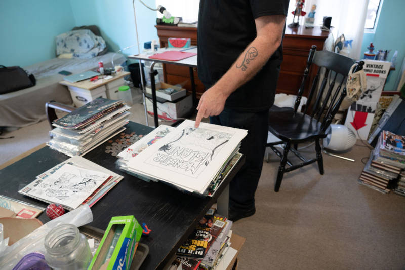 Stacks of comics and drawings abound in Tom Beland's $800/month room in a shared Santa Rosa house.