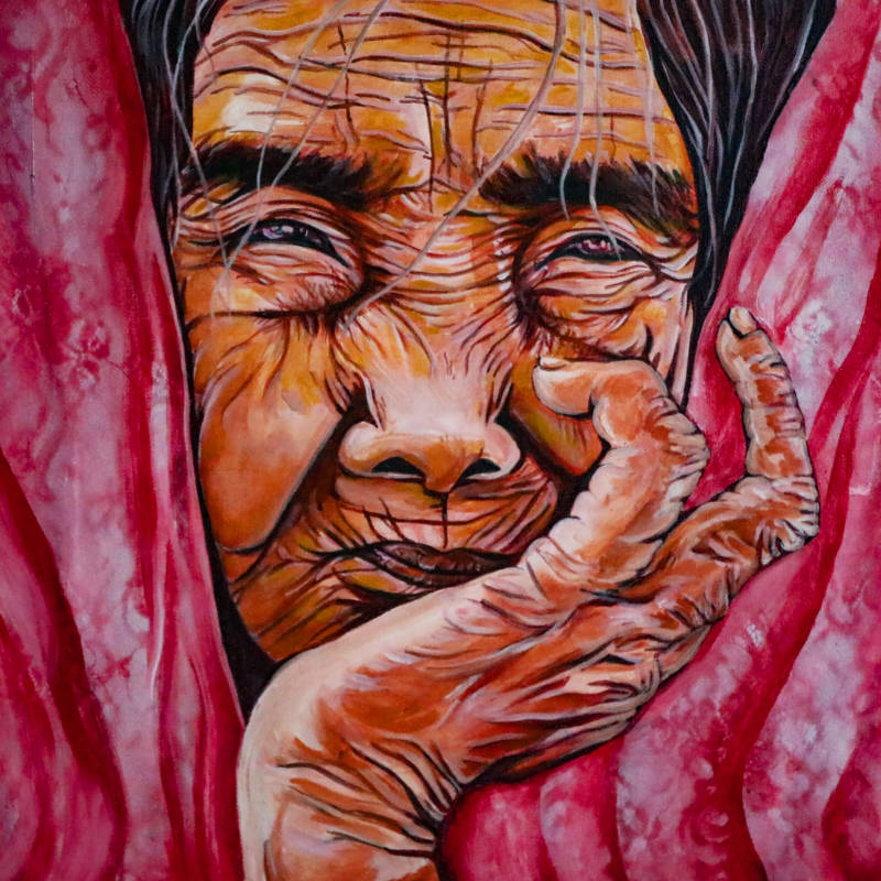 A portrait of Whang-od Oggay from the Butbut community in the Philippines and the world's last mambabatok (hand-tap tattoo artist) from her generation. (courtesy of Cece Carpio)