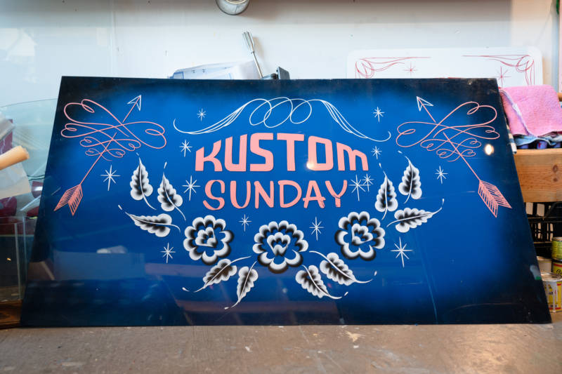 In addition to sign painting and their own art, Isaac Avila and Lauren D'Amato host Kustom Sunday, a car culture meetup in San Francisco.