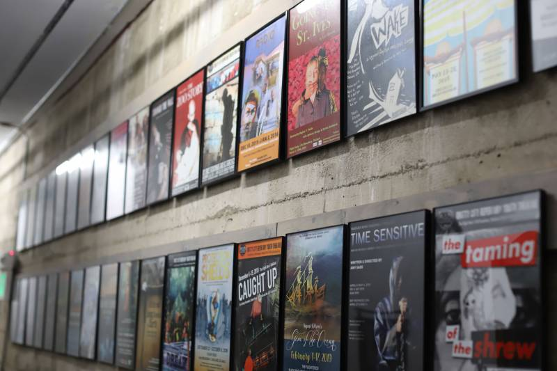 Posters for past productions hang framed in the Flight Deck hallway.