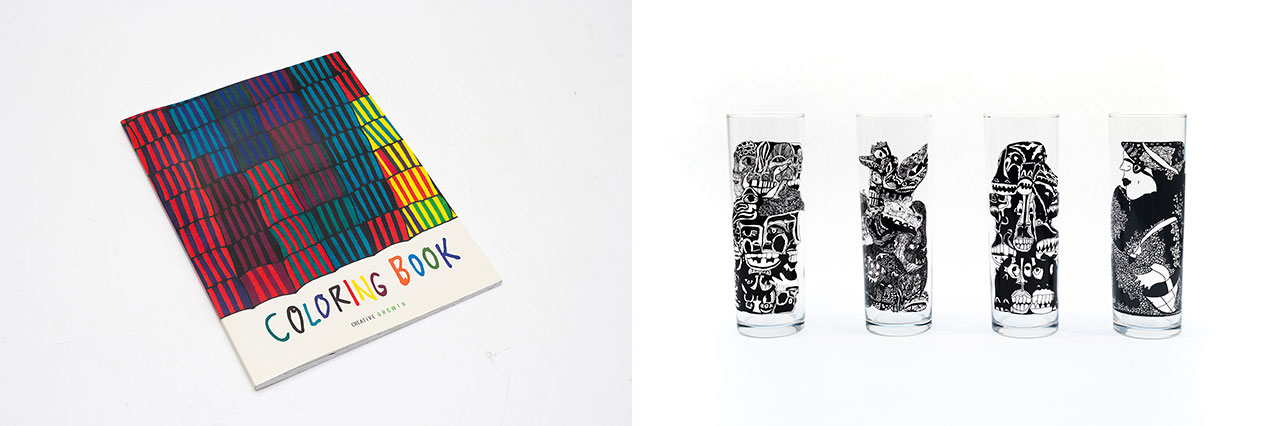 A coloring book cover and four tall clear glasses with intricate black line drawings on them.