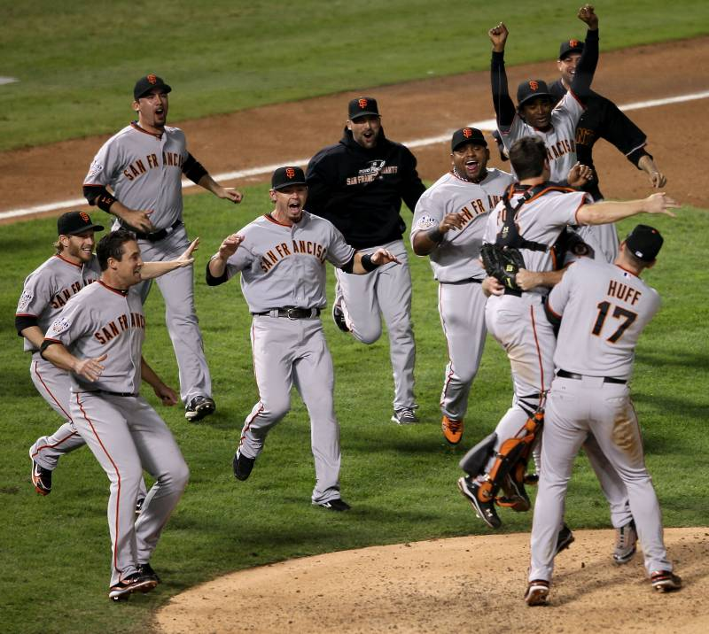 The San Francisco giants run across the field at Rangers Ballpark, celebrating their World Series win in 2010.