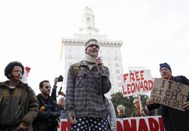 Scott Olsen, a war veteran, who was injured by a police projectile during a Occupy Oakland protest on Oct. 25, speaks in front of Occupy Oakland protesters near Oakland City Hall during the West Coast port blockage on Dec. 12, 2011 in California.