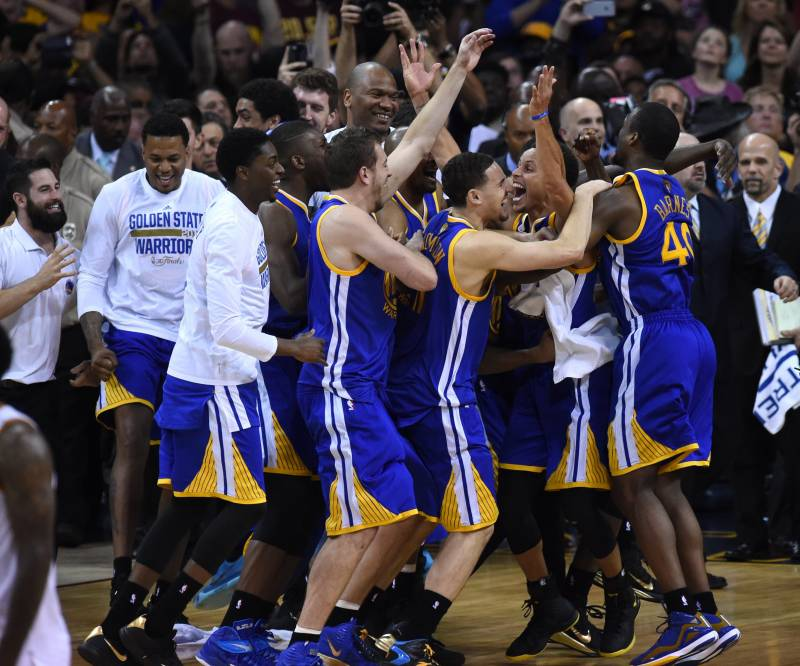 The Golden State Warriors celebrate at the end of Game 6 of the 2015 NBA Finals on June 16, 2015 at the Quicken Loans Arena in Cleveland, Ohio. The Warriors took the best-of-seven series four games to two over the Cavaliers to claim their first title since 1975.