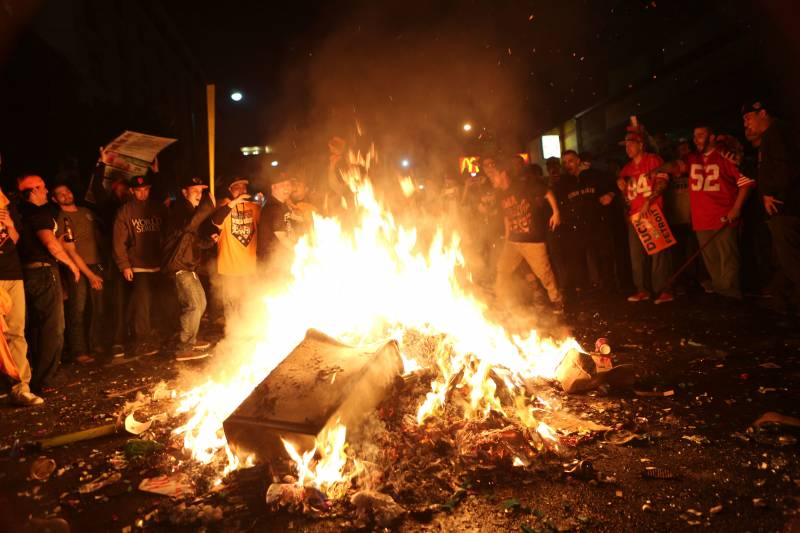 San Francisco Giants fans celebrate their team's winning of the World Series against the Detroit Tigers in San Francisco on Oct. 28, 2012. Fans stand around a pile of burning garbage in the street as the celebration becomes destructive.