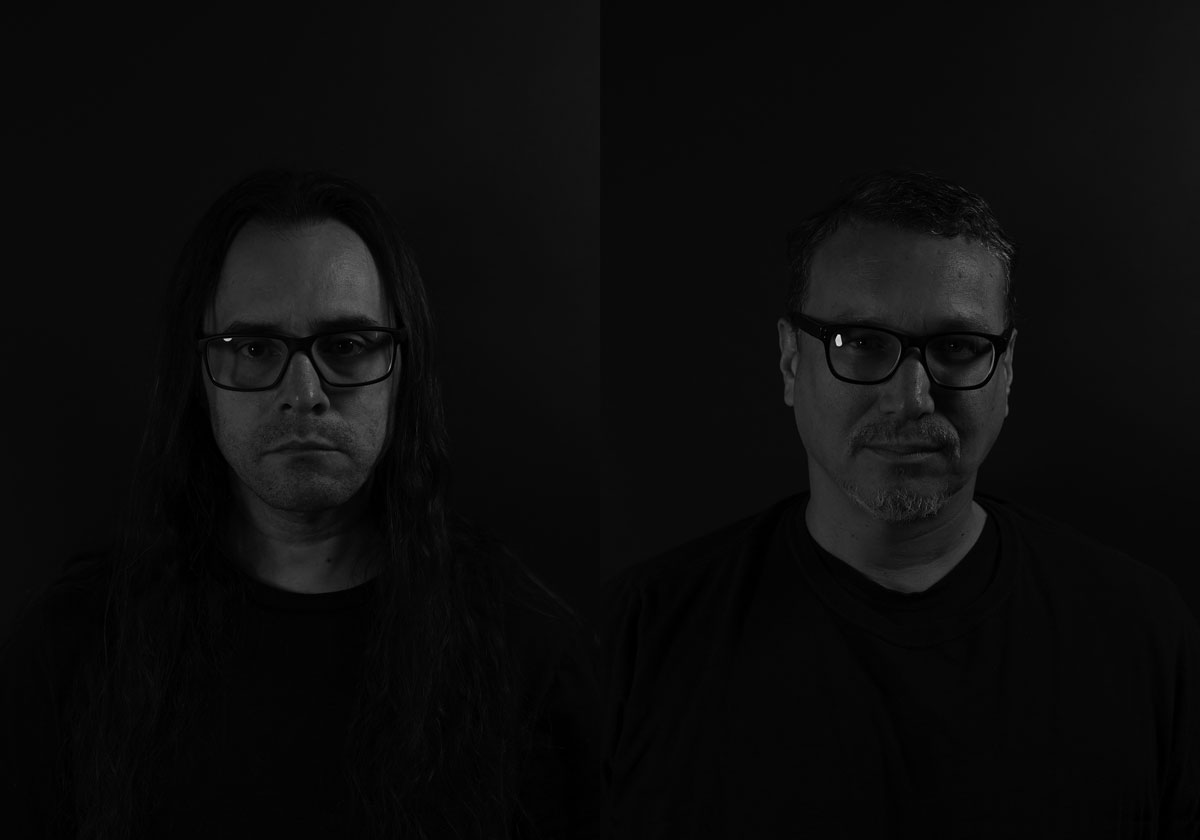Black and white portraits of two men against a black background.