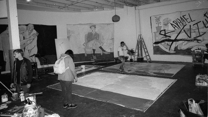 Jeff Cheung (back right) and others prepare for a group show at LoBot Gallery, an unpermitted live-work space in West Oakland that was evicted in 2016.