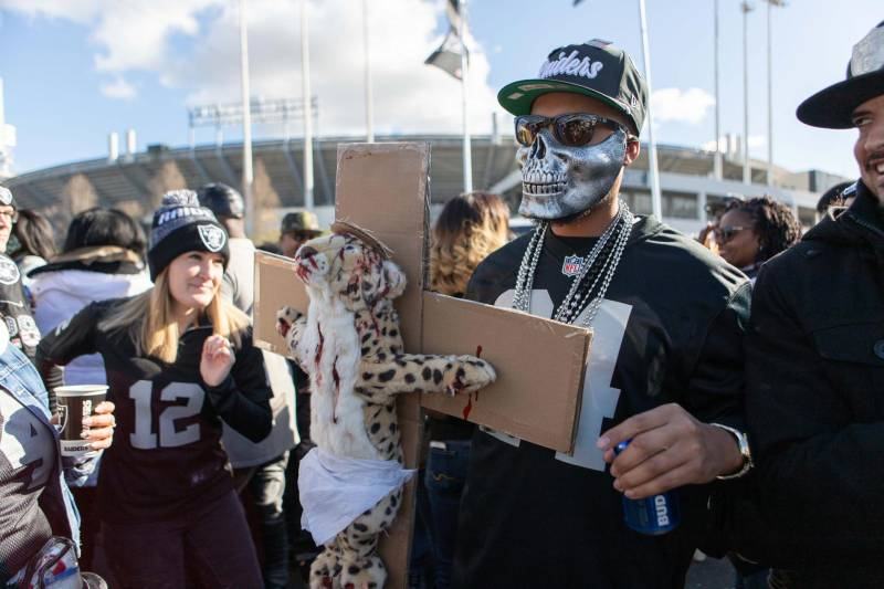 Raiders fans tailgate for the final Raiders home game at the Oakland Coliseum.