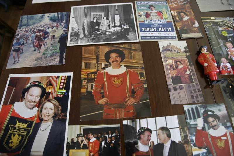 Photographs and memorabilia cover a table at Sweeney's home.