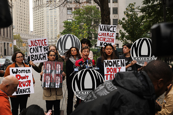 Members of the National Organization for Women (NOW) hold a news conference and demonstration outside of Manhattan Criminal Court, October 13.