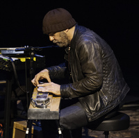 Daniel Lanois, playing pedal steel guitar during a concert at the BAM Howard Gilman Opera House in Brooklyn on April 12, 2014.
