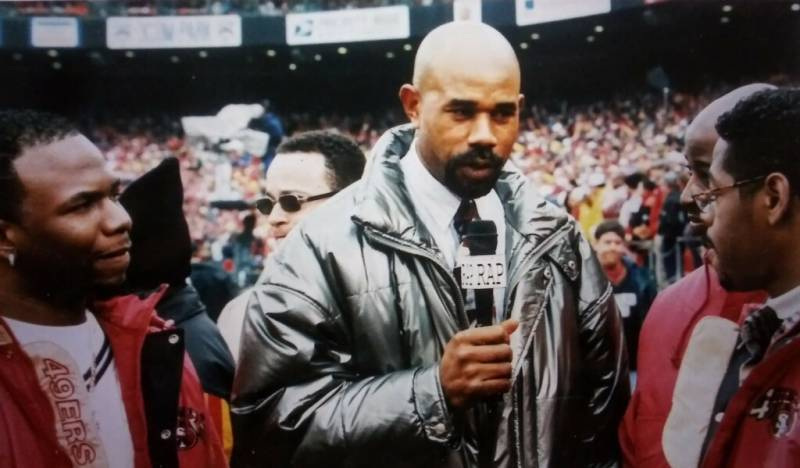 William Hammons interviewing Boy II Men at the NFC Championship Game in 1994