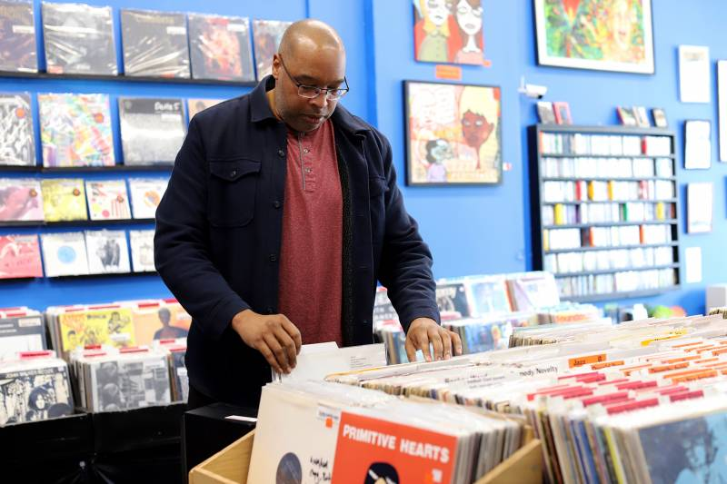 Mark Montgomery French browses the shelves at Econo Jam Records in Oakland.