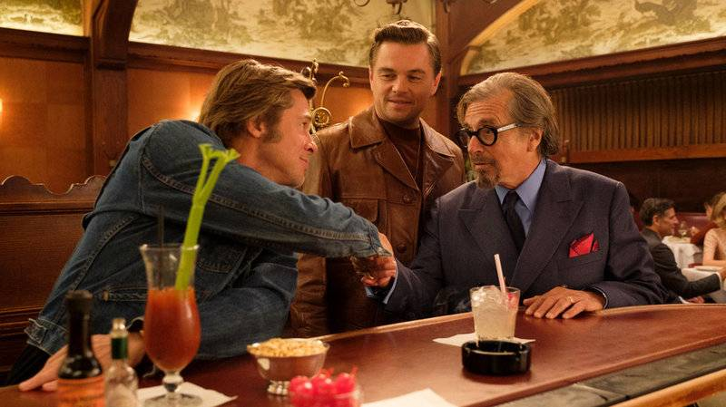 Cliff (Brad Pitt), Rick (Leonardo DiCaprio) and Marvin (Al Pacino) meet at Musso & Frank in 'Once Upon a Time in ... Hollywood.'
