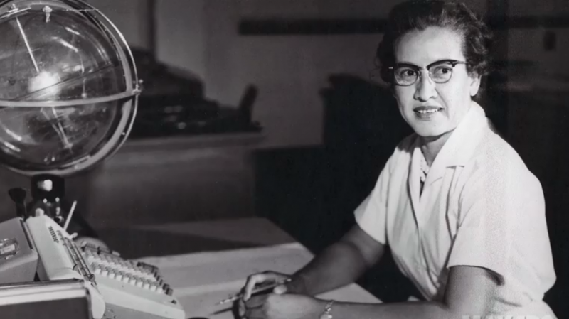 """Johnson at her desk at NASA's Langley Research Center with a globe, or """"Celestial Training Device."""""""