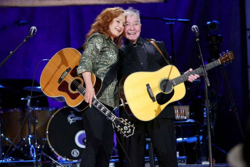 (L-R) Bonnie Raitt and John Prine perform onstage at the Ryman Auditorium in Nashville on September 11, 2019.