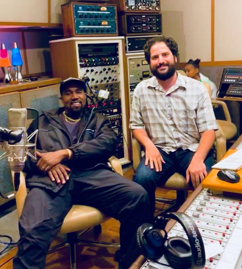 Kanye West with Hyde Street Studios engineer Will Chasen in a recording studio with a mixing console.