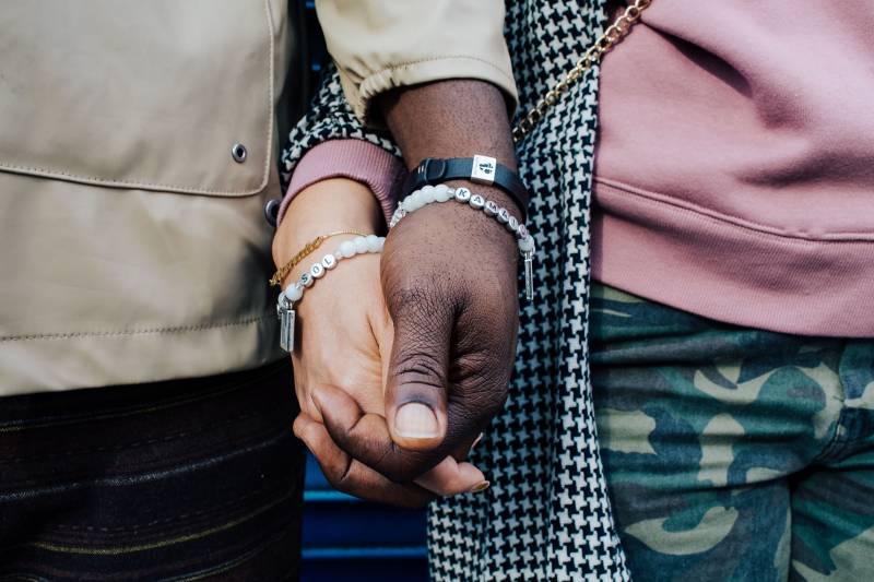 A bracelet dedicated to Kamaiu, aka Baby Bailey, worn by Felicia and Karega.