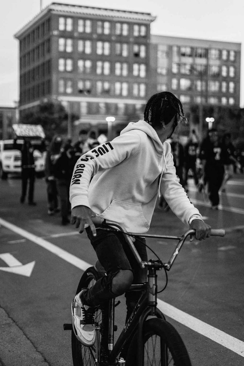 A cyclist amidst a protest in downtown Oakland during the final weekend of May 2020. Photographer Brandon Ruffin says he was hit with rubber bullets and subject to tear gas while taking these photos.