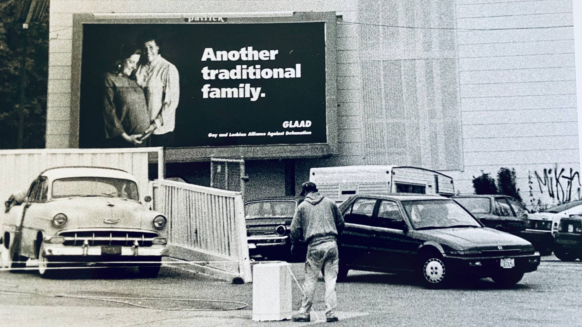 The billboard, photographed by Chloe Atkins and featuring Pat and Karen Norman, on the side of a building in 1992. Courtesy Chloe Atkins
