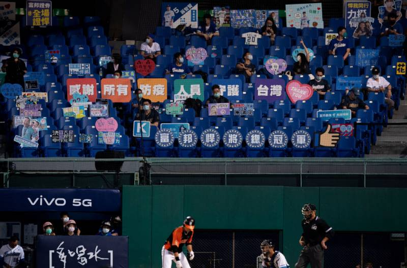 The Fubon Guardians and Uni-Lions play in front of 1000 socially distanced fans at Taipei's Xinzhuang Baseball Stadium on May 08, 2020. The signs in the fifth row offer thanks to first responders.