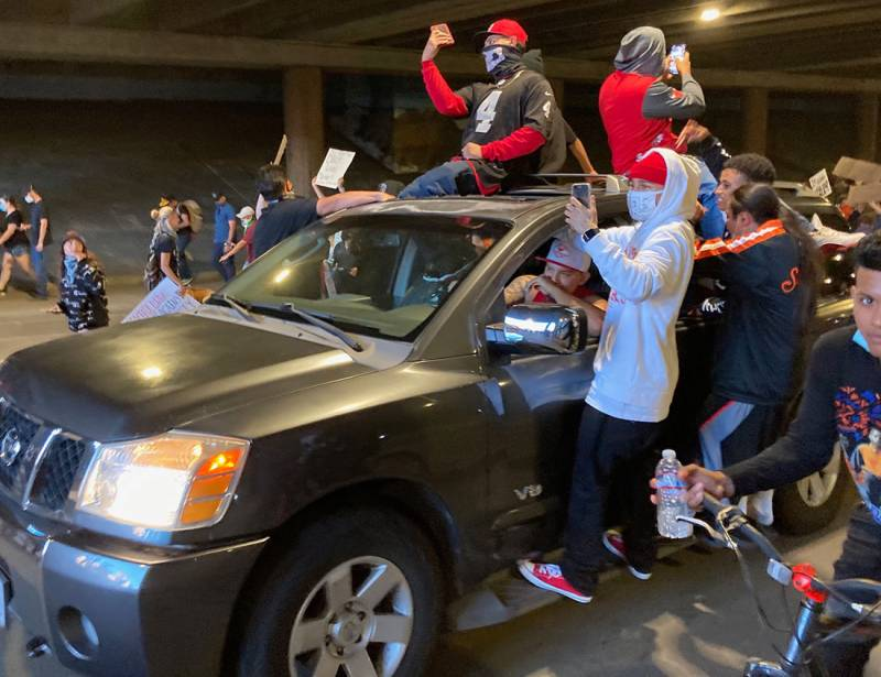 A car of protesters drives beneath the downtown mall in Santa Rosa on Saturday, June 2.