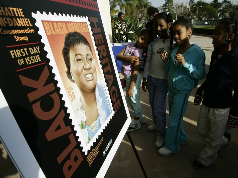 Los Angeles school children attend a ceremony unveiling a commemorative U.S. Postal Service stamp for actor Hattie McDaniel in 2006, in Beverly Hills, Calif. McDaniel, also a singer, radio and television personality, was the first African American to win an Oscar, for her portrayal of Mammy in 'Gone With the Wind.'