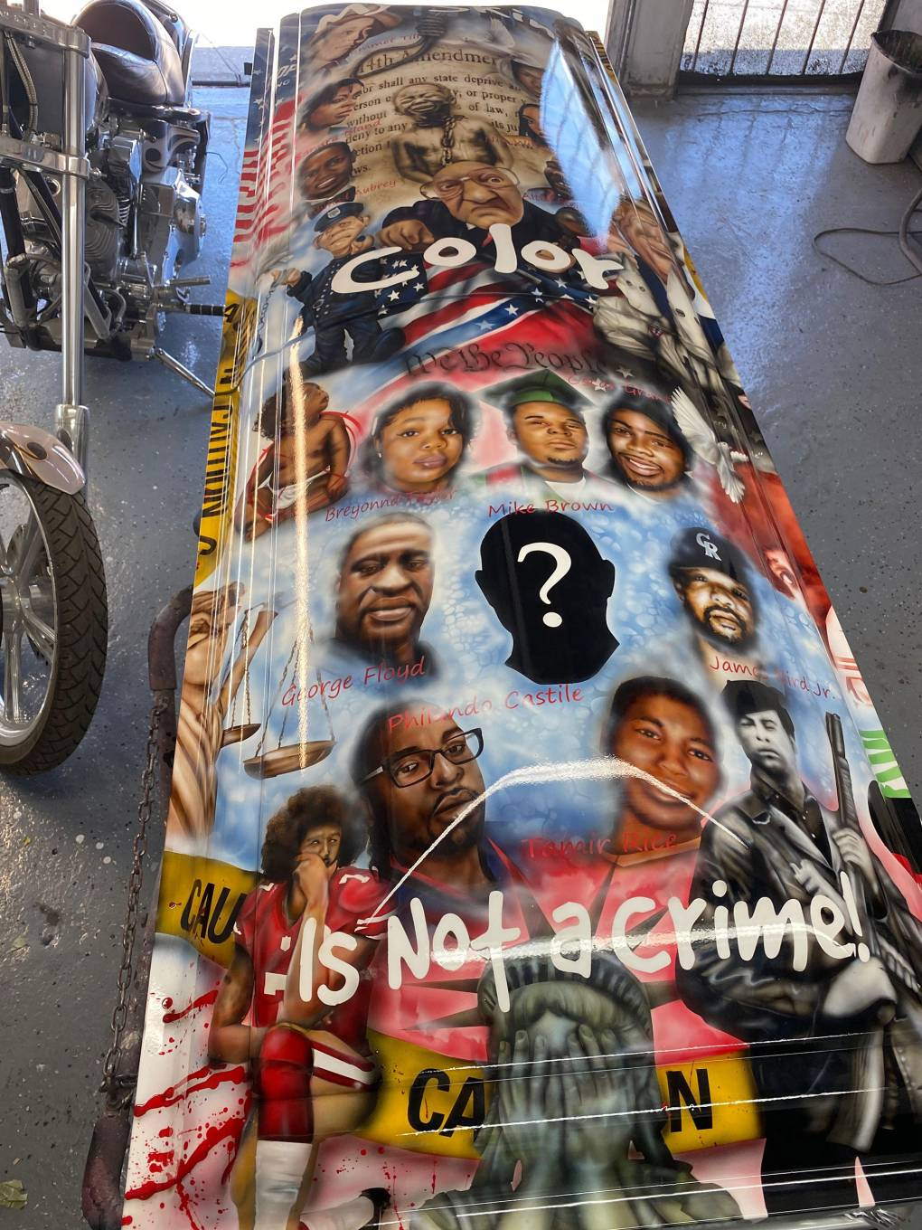 Sandra Bland, the 14th Amendment, an enslaved young man, Trayvon Martin and Nia Wilson all grace the casket created by DeAndre Drake.