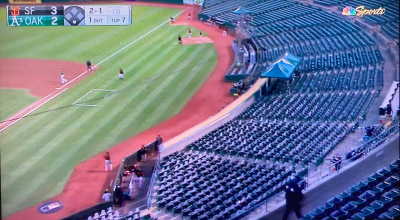 A photo of a television showing the A's vs. Giants exhibition game on July 20, 2020.