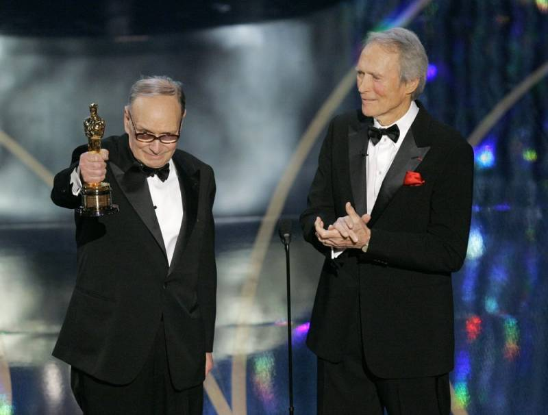 Ennio Morricone, left, accepts an honorary Oscar for his contributions to the art of film music as director Clint Eastwood looks on during the 79th Academy Awards in Los Angeles, in 2007.