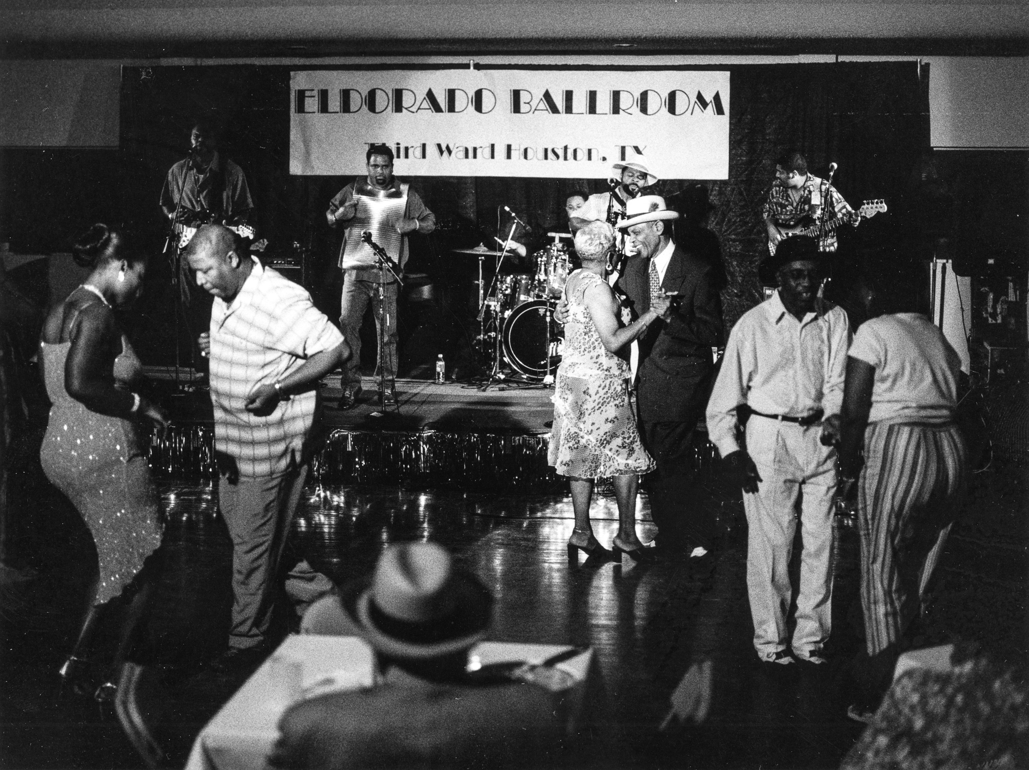 "Juneteenth Dance (with Step Rideau and the Zydeco Outlaws), Eldorado Ballroom, Houston, Texas, 2003. (Photograph by James Fraher, from the books ""Texas Zydeco"" and ""Down in Houston: Bayou City Blues"" by Roger Wood, University of Texas Press)"