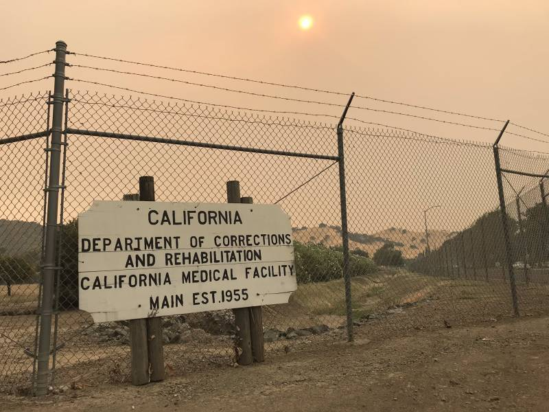 The sign outside of California Medical Facility state prison in Vacaville, on a smoky hot August afternoon